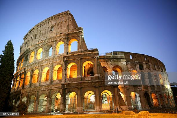 coliseum by night - coliseum rome stock photos and pictures