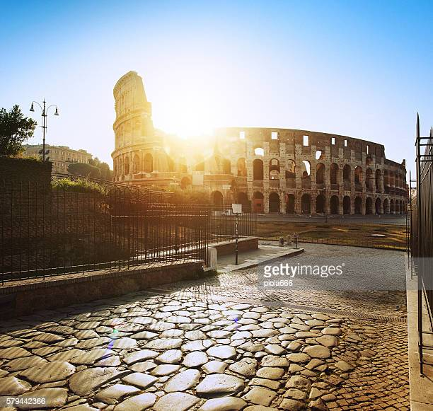 Coliseum of Rome, just restored, from Via Sacra at dawn