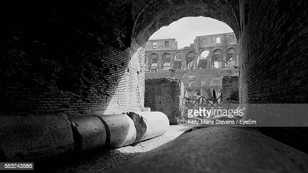 coliseum seen from arch - inside the roman colosseum stock photos and pictures