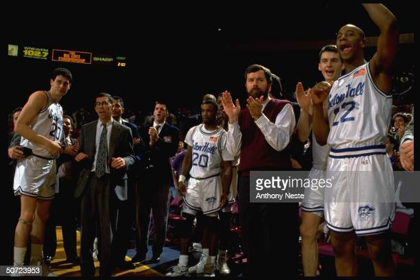 Big East. Seton Hall Oliver Taylor on sidelines w. Coach Carlesimo & teammates.