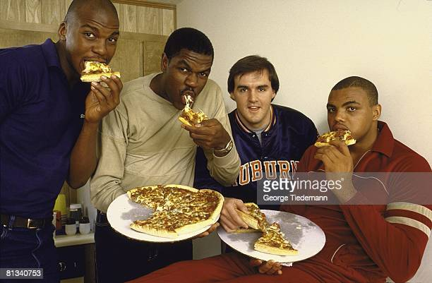 Coll Basketball Closeup casual portrait of Auburn Charles Barkley at home eating pizza with teammates Auburn AL 3/2/1984