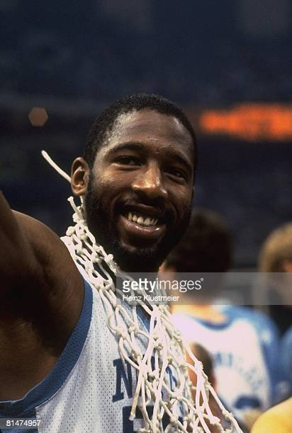 Coll Basketball NCAA finals Closeup of North Carolina's James Worthy victorious wearing net around neck after game vs Georgetown New Orleans LA...