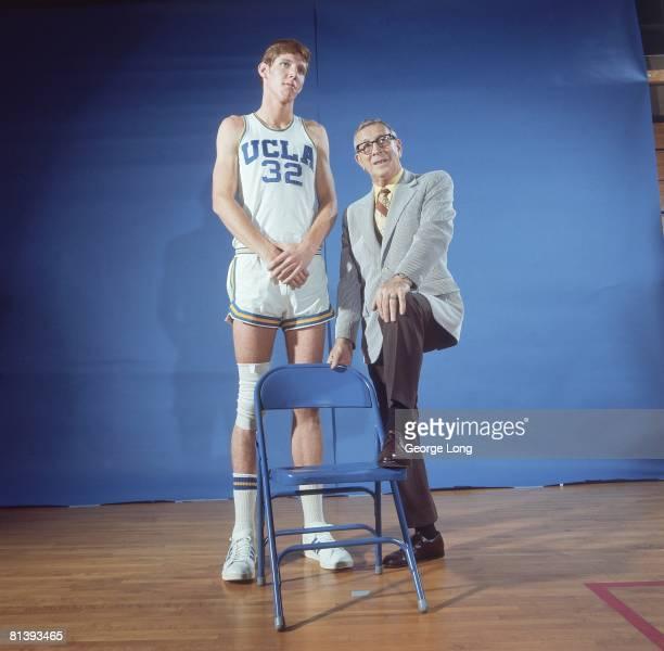 Coll Basketball UCLA coach John Wooden with Bill Walton