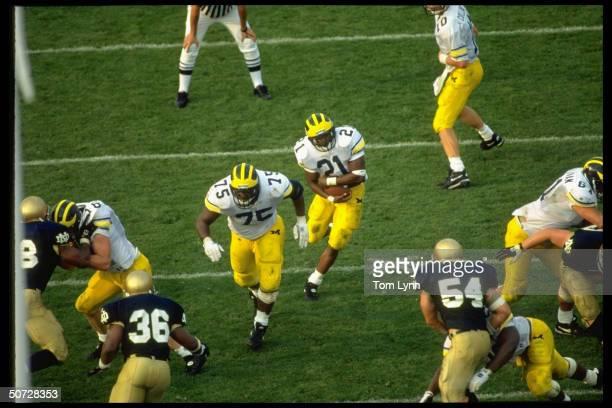 Aerial view of Michigan's Tim Biakabutuka & Thomas Guynes in action vs Notre Dame.; Biakabutka rushing, Guynes blocking.;