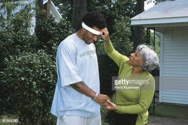 Coll Football Casual portrait of North Carolina's Julius Pepper with mom Bessie Chapel Hill NC 7/11/2001