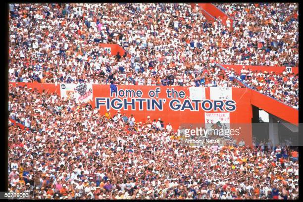 Florida stands w fans and bleacher saying HOME OF THE FIGHTIN' GATORS