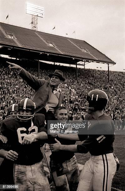 Coll Football Iron Bowl Alabama coach Paul Bear Bryant victorious with team after game vs Auburn and perfect season Birmingham AL 12/2/1961