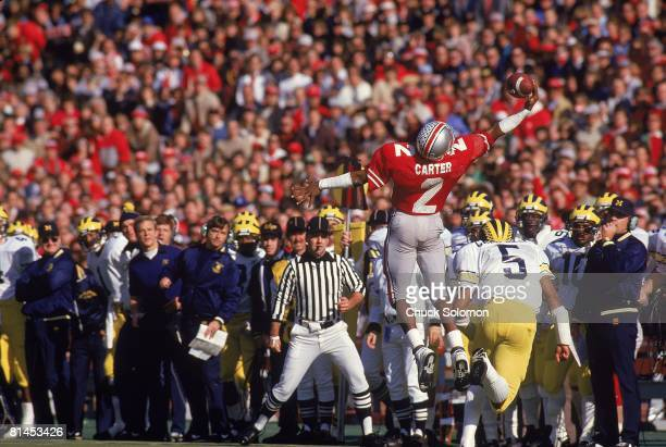 Coll Football Ohio State's Cris Carter in action making interception vs Michigan's Erik Campbell Columbus OH
