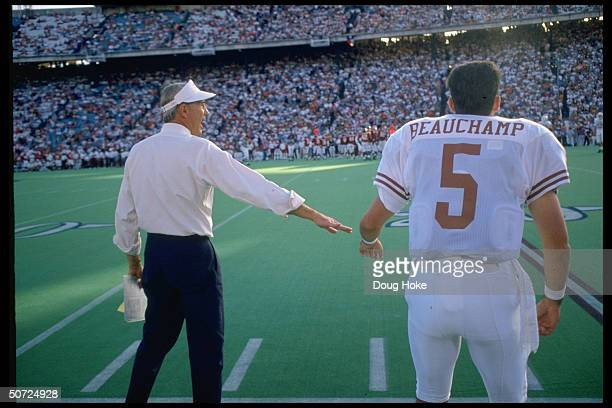 Portrait of Texas Longhorns Beauchamp w Coach John Mackovic on the sidelines