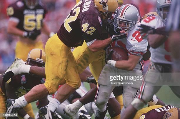 Coll Football Rose Bowl Arizona State's Pat Tillman in action making tackle vs Ohio State's Matt Keller Pasadena CA 1/1/1997