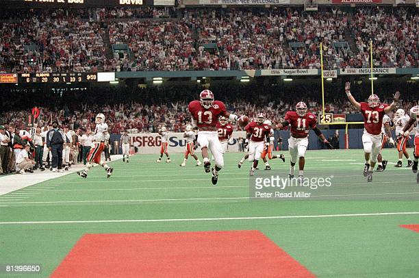 Coll Football Sugar Bowl Alabama's George Teague in action and victorious returning interception for TD vs Miami New Orleans LA 1/1/1993