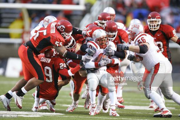 Coll, Football: UNLV's Dominique Dorsey in action, getting tackled vs Utah's Marquess Ledbetter , Eric Weddle , Tommy Hackenbruck , and Spencer Toone...