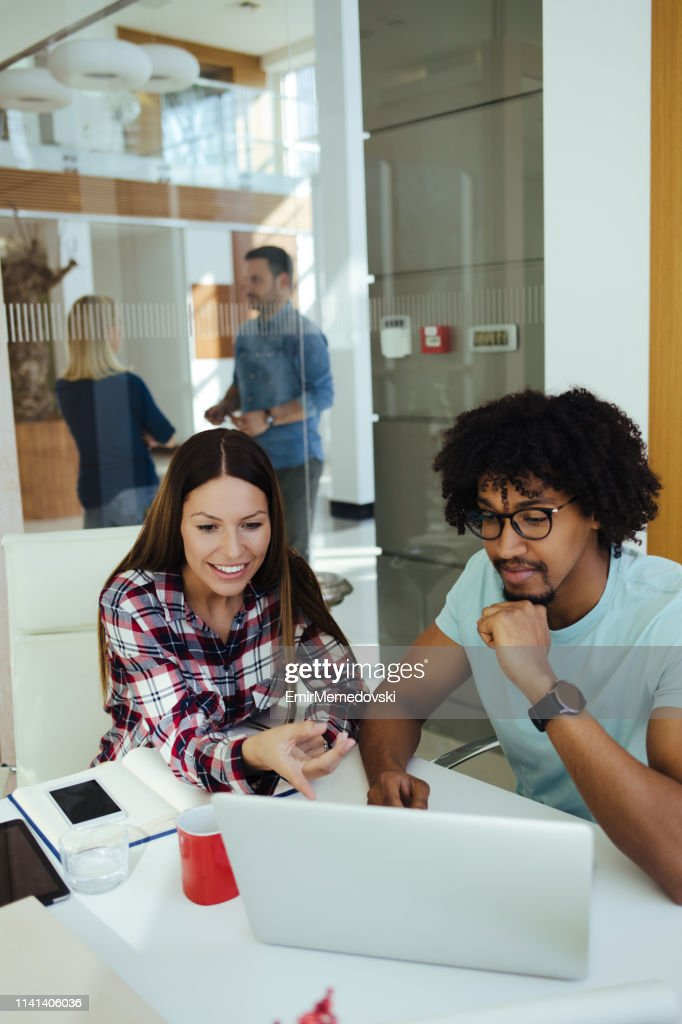 Collaborating at work : Stock Photo