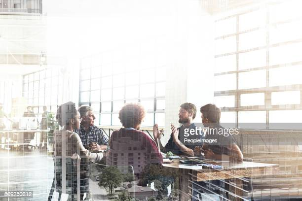 collaborating to build the city of their dreams - discussion stock photos and pictures