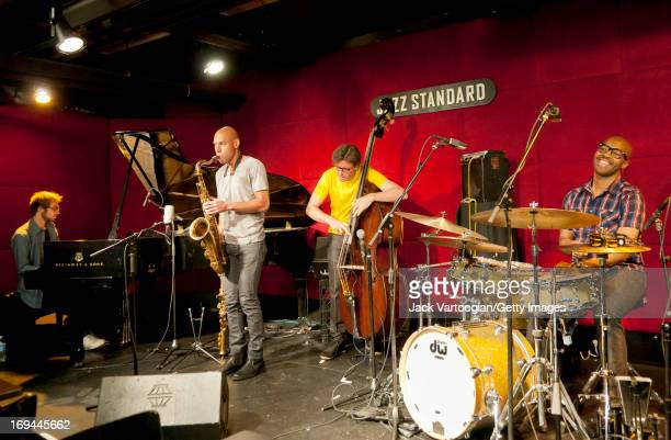 Collabortive jazz quartet James Farm perform on stage at the Jazz Standard New York New York June 16 2011 Pictured are from left Aaron Parks on piano...