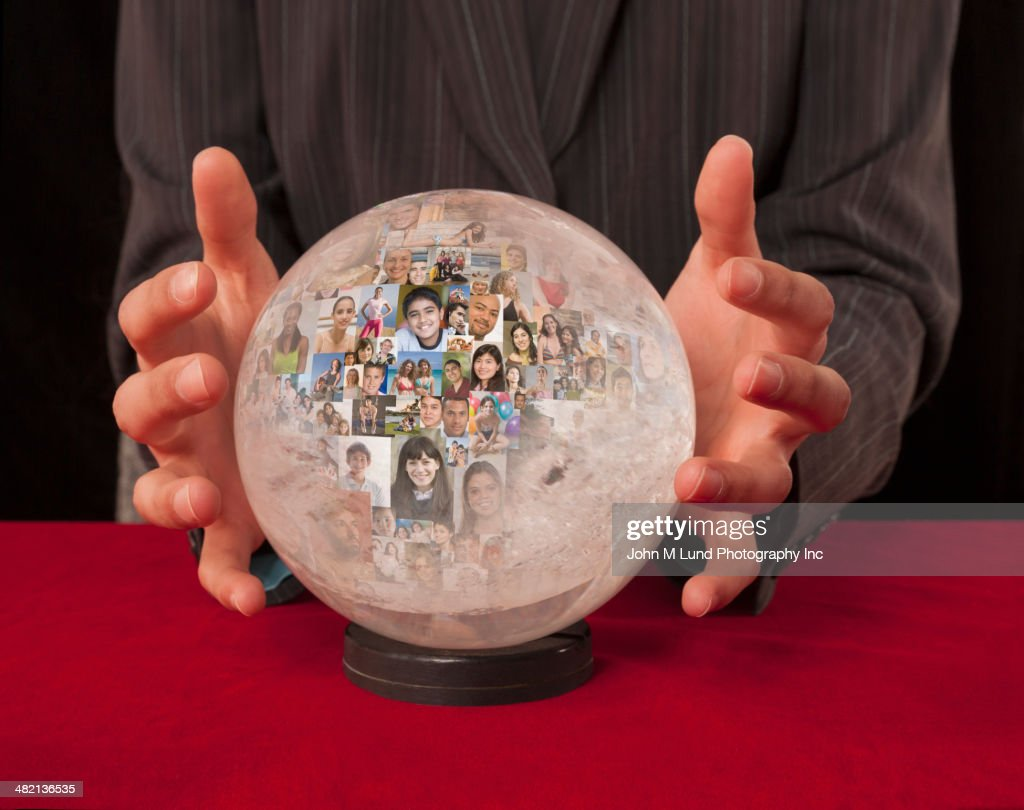 Collage of business people's faces in crystal ball : Stock Photo