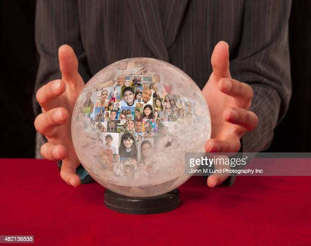 Collage of business people's faces in crystal ball