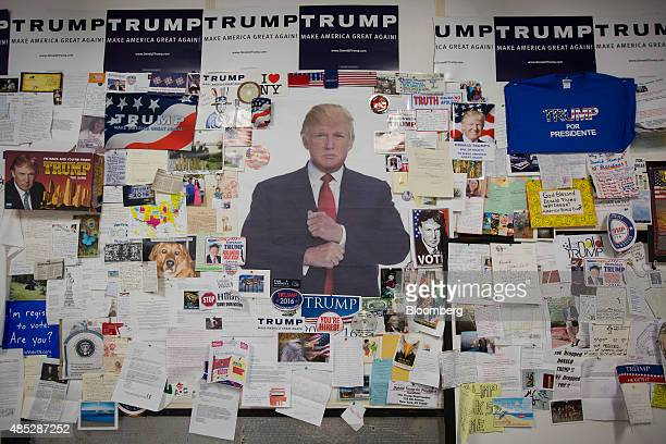 A collage of Donald Trump president and chief executive of Trump Organization Inc and 2016 Republican presidential candidate memorabilia hangs on a...