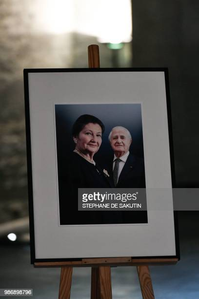 A collage of images of the late politician Simone Veil and her husband Antoine Veil next to their coffins at French Holocaust memorial in Paris on...