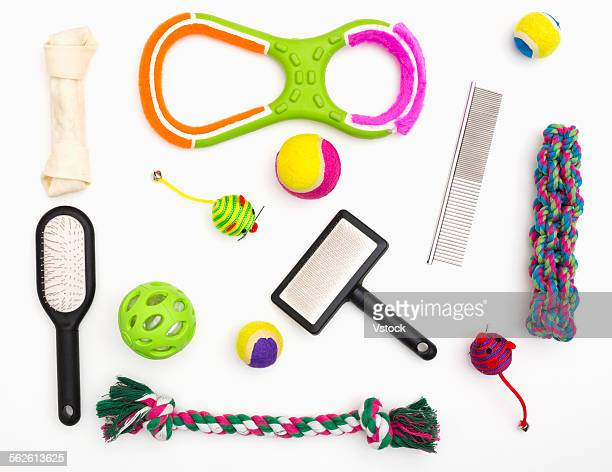 Collage of pet toys and combs on white background