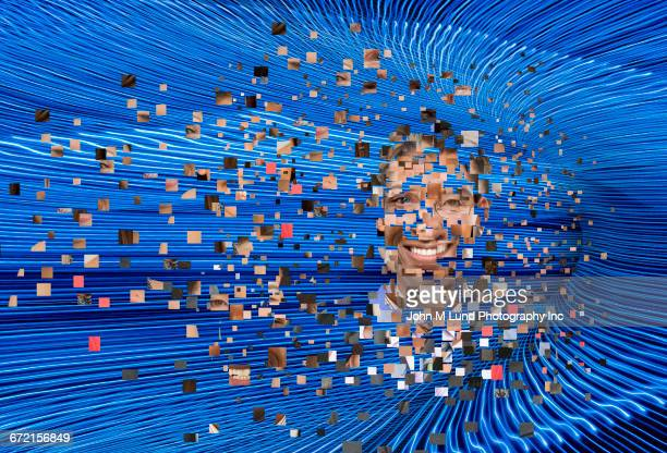 Collage of pixels forming human face in flowing beams of hi-tech energy