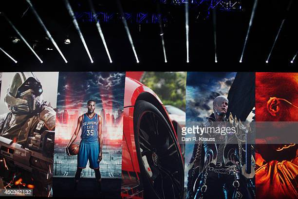 A collage of PS4 games are displayed during the Sony press conference at E3 June 9 2014 in Los Angeles California The annual video game conference...