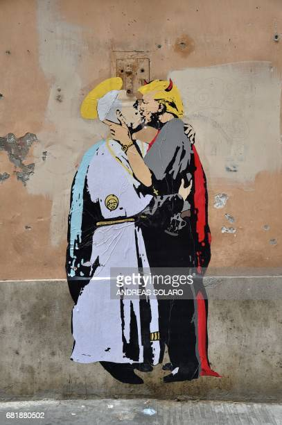 A collage shows Pope Francis kissing US President Donald Trump with a caption by artist TvBoy reading in English and Italian The Good forgives the...