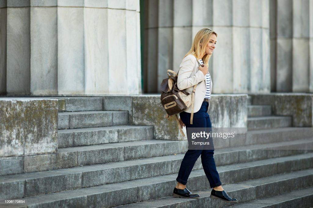 Collage student walking down the Buenos Aires law school steps. : Stock Photo