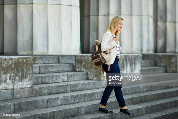 collage student walking down the buenos aires law school steps. - universidad stock pictures, royalty-free photos & images
