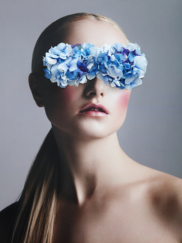 Collage with female portrait and blue flowers - gettyimageskorea