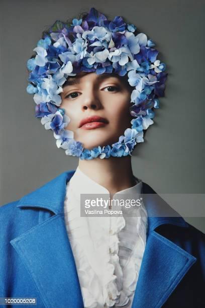 collage with female portrait and blue flowers - arts culture et spectacles photos photos et images de collection