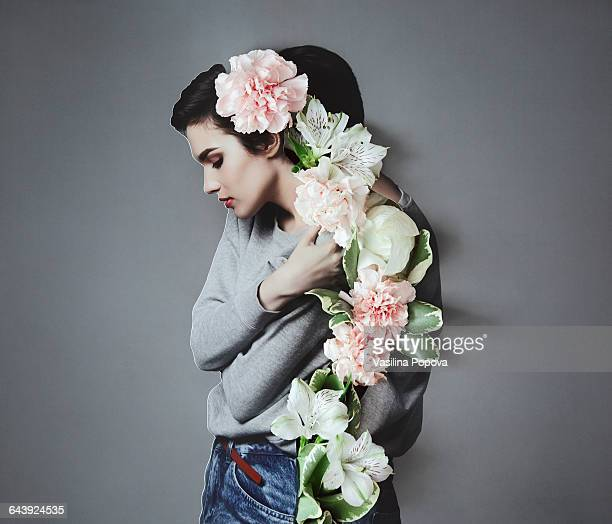 Collage with female portrait and flowers