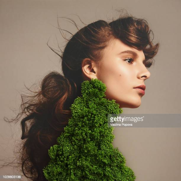 collage with female portrait and green plant - moos stock-fotos und bilder