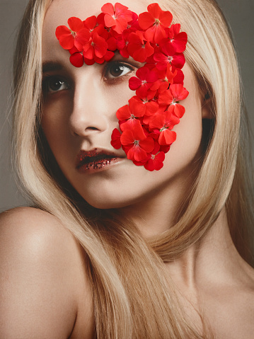Collage with female portrait and red flowers - gettyimageskorea