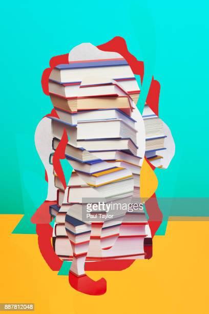 collaged stack of books - littérature photos et images de collection