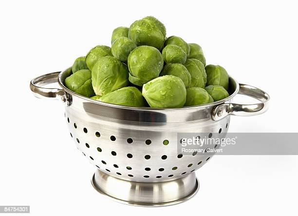 Collander filled with brussel sprouts.