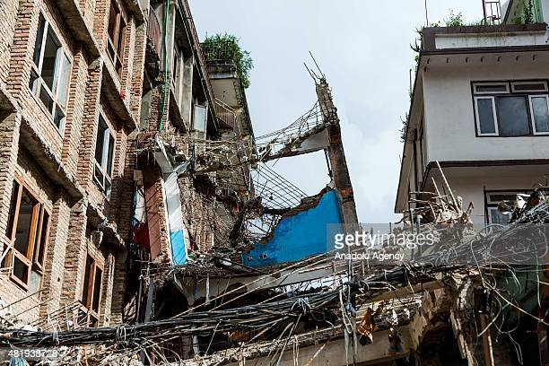 Collapsed and destroyed building rests along side another destroyed building n Kathmandu, Nepal on July 25, 2015. Today marks the 3 month anniversary...