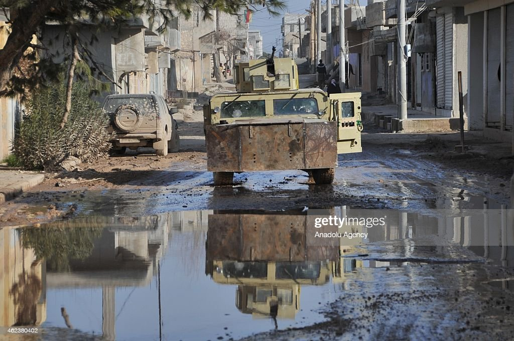 Collapsed buildings and damaged cars are seen in border town of Kobani of Aleppo, Syria on January 27, 2015 after it has been freed from Islamic State of Iraq and the Levant (ISIL) forces.