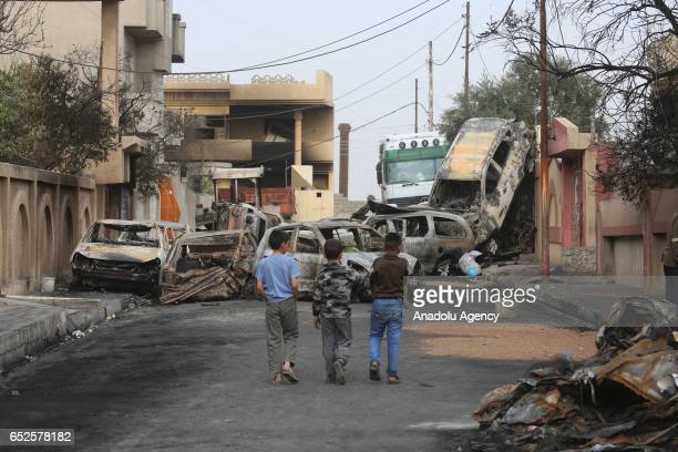 Collapsed buildings and damaged vehicles are seen during an operation to retake Mosul from Daesh terrorists in Samun neighborhood as the clashes...