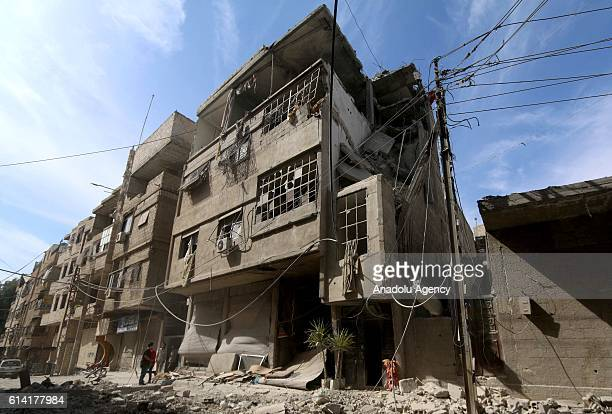Collapsed buildings are seen after warcrafts belonging to the Assad Regime forces carried out an airstrike over residential areas at opposition...