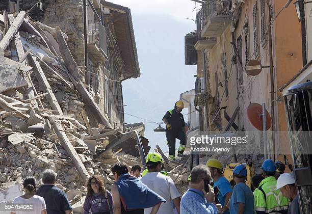 Collapsed buildings are seen in Amatrice, central Italy on August 24, 2016 following a 6.2 magnitude earthquake, according to the United States...