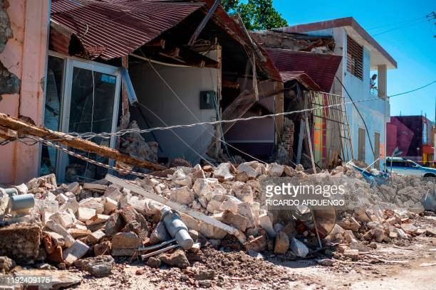 TOPSHOT A collapsed business is seen after an earthquake hit the island in Guanica Puerto Rico on January 7 2020 A strong earthquake struck south of...