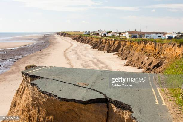 a collapsed coastal road between skipsea and ulrome on yorkshires east coast - house collapsing stock pictures, royalty-free photos & images