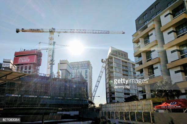 A collapsed crane is seen leaning on an apartment buliding at Wolli Creek on August 7 2017 in Sydney Australia Around 200 people have been unable to...