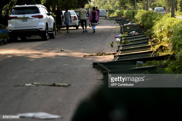 A collapsed divider fence is seen at Panchkula on August 26 after followers of controversial guru Ram Rahim Singh on August 25 went on a rampage...