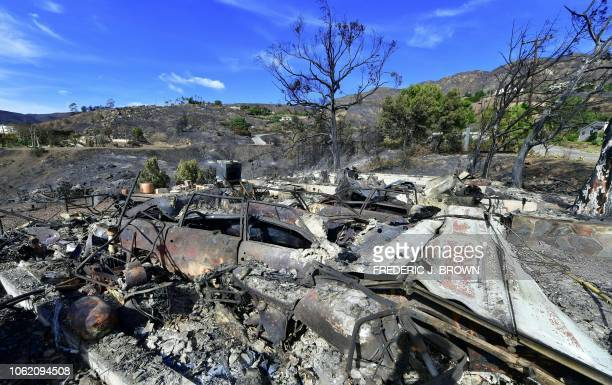 A collapsed garage door is recognizable amid the rubble of a house off Encinal Canyon Road destroyed by the Woolsey Fire in Malibu California on...