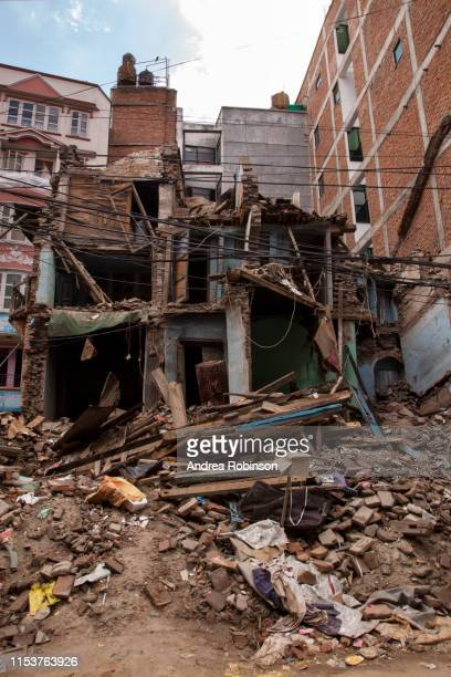 collapsed house amongst houses still standing, post earthquake street scene, kathmandu june 2015 - refugee camp stock pictures, royalty-free photos & images