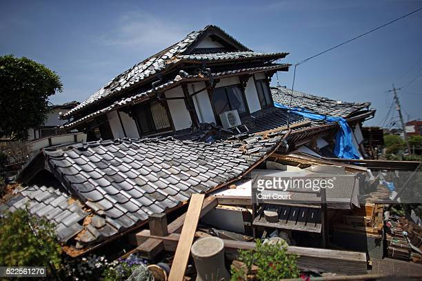 A collapsed house is pictured following an earthquake on April 20 2016 in Mashiki near Kumamoto Japan As of April 20 48 people were confirmed dead...
