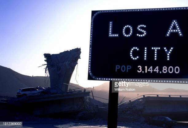 Collapsed interchanges of Interstate 5 with California State Route 14 and Interstate 210 are shown behind the Los Angeles city limit sign after the...
