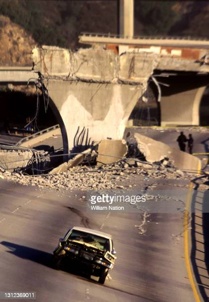 Collapsed interchanges of Interstate 5 with California State Route 14 and Interstate 210 are shown with a wrecked car after the 1994 Northridge...